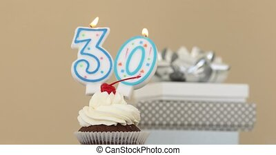 Thirty 30 candle in cupcake pastel background - Number...