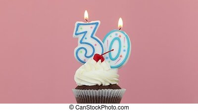 Thirty 30 candle in cupcake pink background - Number thirty...
