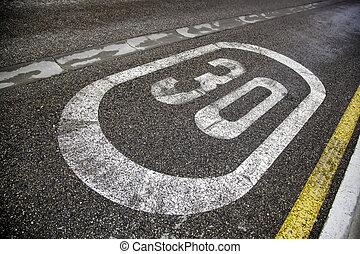 Thirty sign on the asphalt