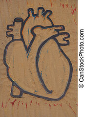 This image is of a block of linoleum that has been carved using wood carving tools into the shape of an anatomical heart. This process is commonly referred to as block printing, and can also be done u
