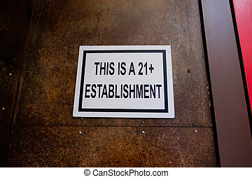 This Is A 21+ Establishment - Bar sign outside says no...