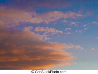 cloud illuminated by the setting sun