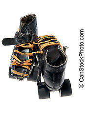 This is a pair of old dirty black roller skates (...