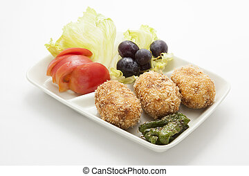 This is a photo of a garnish and croquettes.
