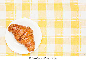 croissant on the table cloth