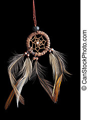 dream catcher - This is a small dream catcher over a black...
