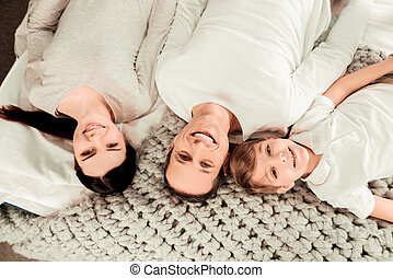 Top view of a positive happy family