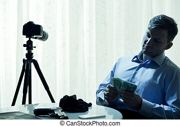 This is risky job but profitable - Man sitting beside table...