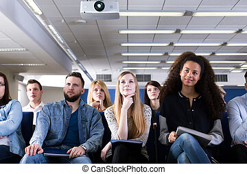 This is very interesting lecture - Group of students sitting...