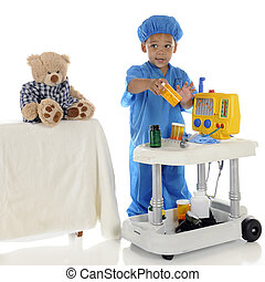"This One? - An adorable preschool ""doctor"" in blue scrubs..."