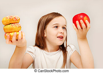 This photo depicts a young girl making decisions betwen ...