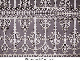 This picture shows the pattern of iron gate painted in plain white colors.