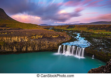 Thjofafoss waterfall in Iceland at colorful sunset