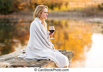 thoughful woman with a glass of red wine