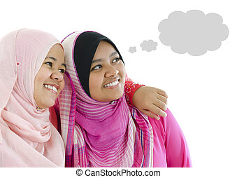 Thought Bubble - Two Muslim women having thought together,...