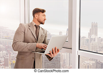 Thoughtful adult businessman working in the office