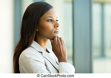 thoughtful african businesswoman in office