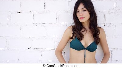 Thoughtful attractive woman in a bikini