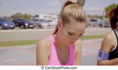 Thoughtful attractive young blond woman