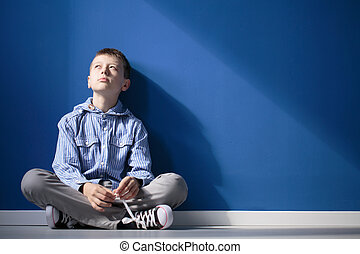 Thoughtful autistic boy