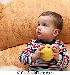 Thoughtful baby with apple