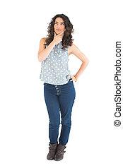 Thoughtful beautiful brunette posing