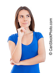 Thoughtful beauty. Beautiful young woman holding hand on chin and looking away while standing isolated on white