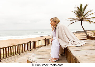 blonde woman looking into distance - thoughtful blonde woman...
