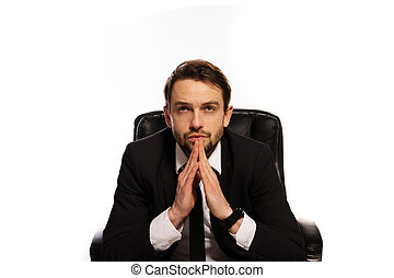 Thoughtful boss sitting at his desk