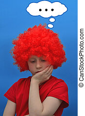 Thoughtful boy - Funny boy in red curly wig makes pensive...