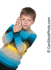 Thoughtful boy with a cell phone