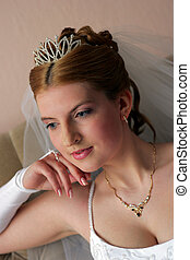 Thoughtful bride in white