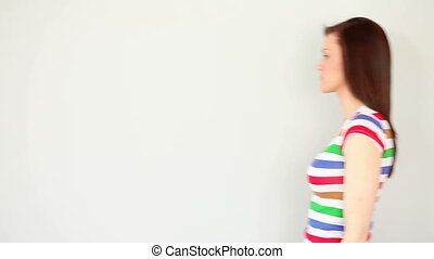 Thoughtful brunette posing on white background