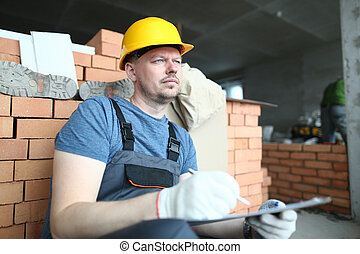 Thoughtful builder in hardhat