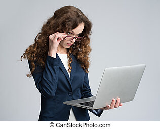 business woman looking at laptop