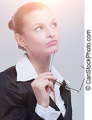 Thoughtful business woman looking confident . Isolated on gray