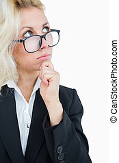 Thoughtful business woman looking up with hand on chin over