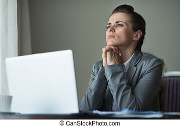 Thoughtful business woman working at desk