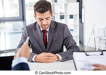 thoughtful businessman having job interview, business concept