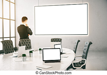 Thoughtful businessman in meeting room