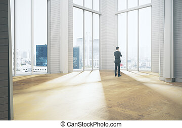 Thoughtful businessman in room