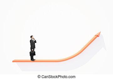 Thoughtful businessman on chart arrow