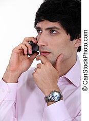 Thoughtful businessman on the phone