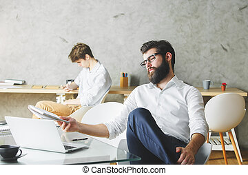Thoughtful businessman using laptop