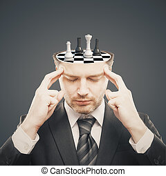 Brainstorming concept - Thoughtful businessman with chess...