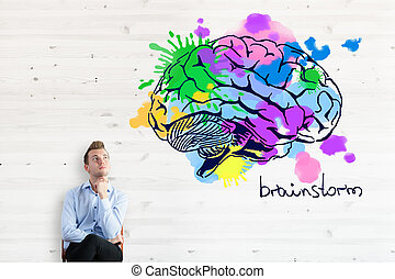 Brainstorm concept - Thoughtful businessman with colorful...