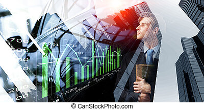 Thoughtful businessman with diary in hands
