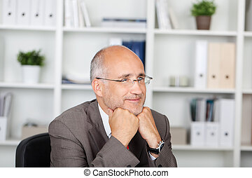 Thoughtful Businessman With Hands On Chin Looking Away