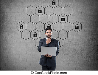 Thoughtful businessman with hexagonal lock security concept