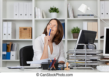 Thoughtful Businesswoman Looking Up In Office